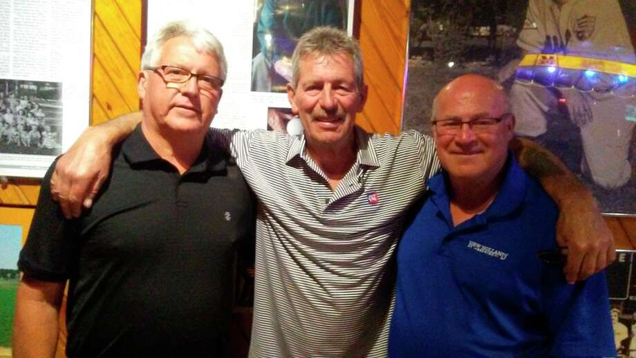 DAN CHALK | chalk@mdn.net Teammates on the 1979 Midland McArdle fastpitch national championship team, from left, Jim Wright, Owen 'Fog' Walford, and Jack Starling had a reunion Wednesday at the Boulevard Lounge. Walford is visiting the United States from New Zealand, and this was the third reunion of former fastpitch teammates that he had attended on his trip. Also at the McArdle reunion, but not pictured, was Nels Cronkright.