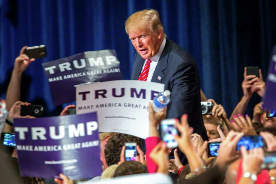 Republican Presidential candidate Donald Trump addresses supporters during a political rally at the Phoenix Convention Center on Wednesday in Phoenix, Arizona. Trump spoke about illegal immigration and other topics. This followed a meeting he had in Mexico City with Mexican President Enrique Peña Nieto. Photo: Charlie Leight /Getty Images / 2015 Getty Images