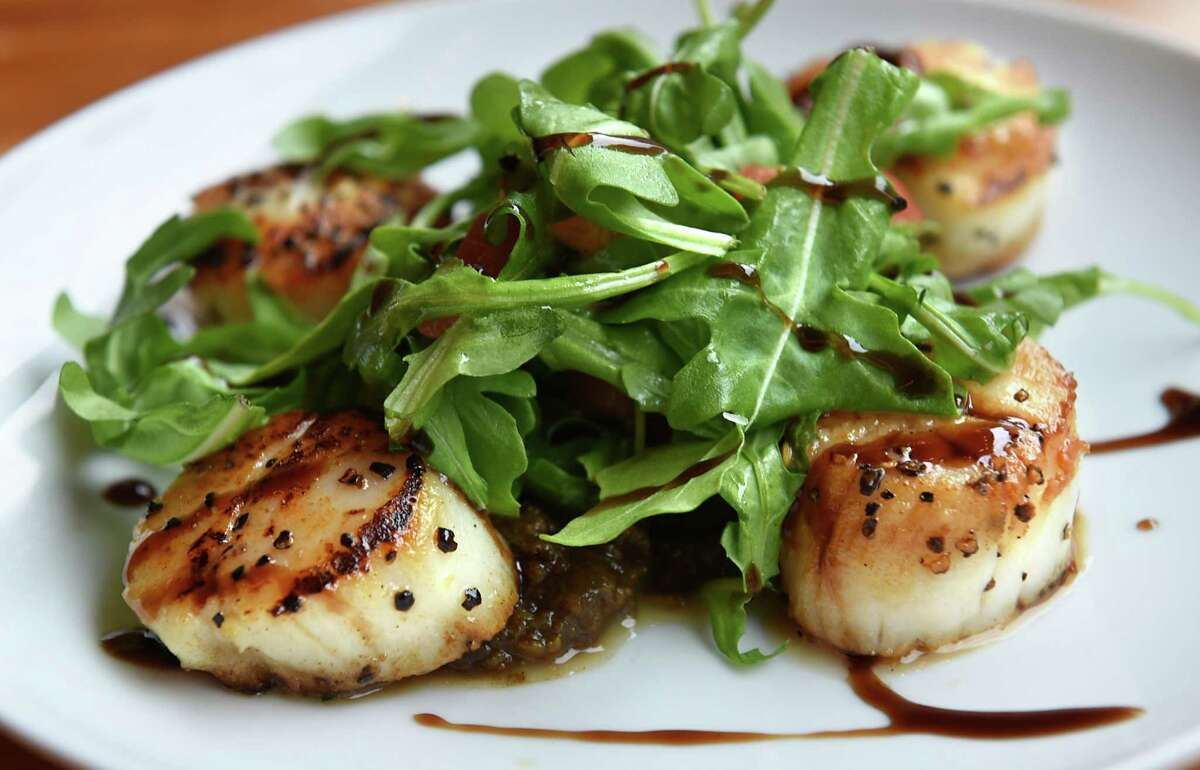 Sea scallop plate at The Hollow restaurant on Thursday, Aug. 25, 2016 in Albany, N.Y. Pan-seared sea scallops, pear chutney, arugula, tomato, fig molasses. (Lori Van Buren / Times Union)