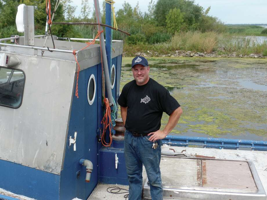 Tyler Williams, who is one of the current co-owners of the Bay Port Fish Company, shows off the Patsy. The other boats are the Osprey and the Argo. The other co-owners are Tod and Lakon Williams. / Copyright 2012