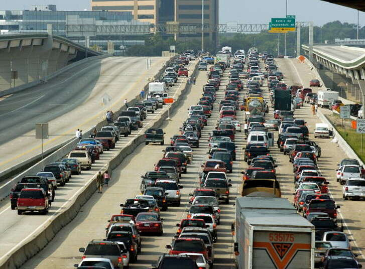 Houston, UNITED STATES:  Vehicles jam the northbound lanes (R) of I-45 as the southbound lanes (L) are empty in Houston, Texas, 22 September 2005, as people from south Texas evacuate in advance of Hurricane Rita.   AFP PHOTO/Stan HONDA  (Photo credit should read STAN HONDA/AFP/Getty Images)