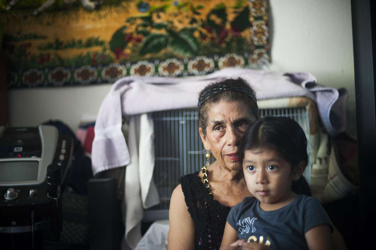 Farmworker Obdulia Salinas with her granddaughter Eneya, photographed at her home in Santa Rosa, CA on August 31, 2016. Recent state legislation is headed to the governor's office that would provide farmworkers overtime pay after eight hours of work.