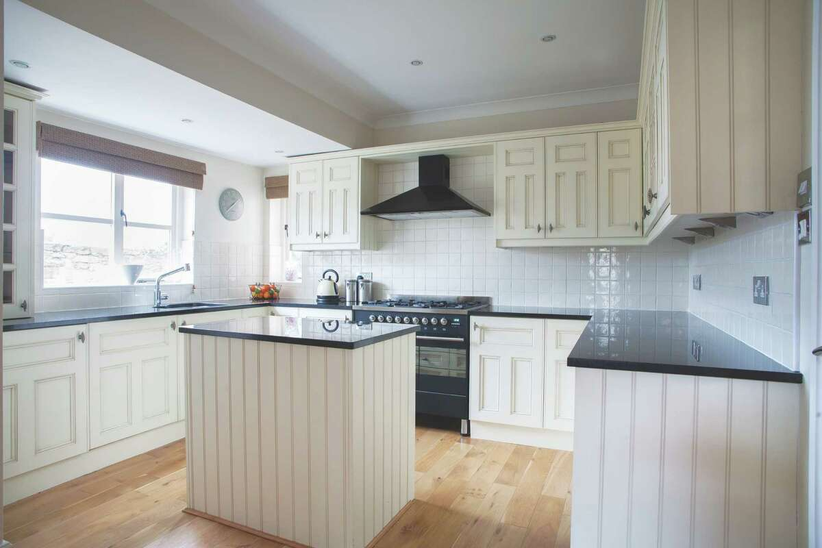 All white kitchen may look clean, but can lower your home value. (Getty Images)