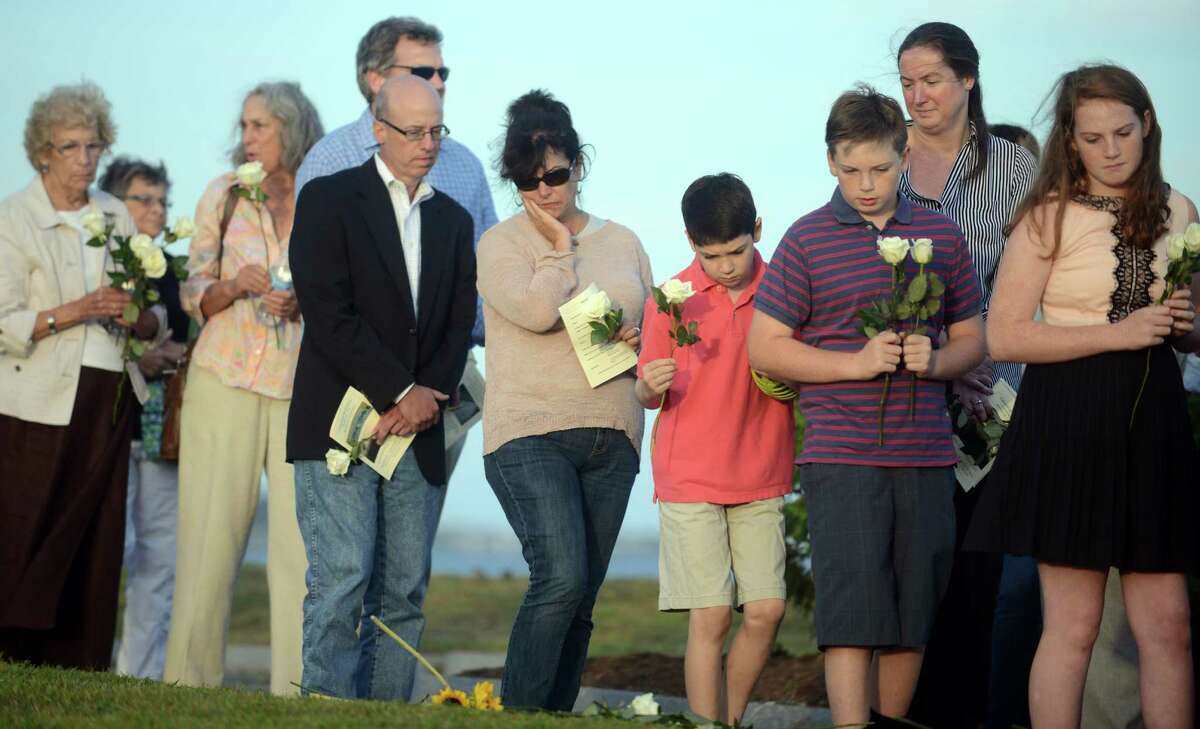 Residents honor those killed in the September 11, 2001 terrorist attacks Wednesday, Sept. 10, 2014 during Connecticut's 12th annual 9/11 ceremony at Sherwood Island State Park in Westport, Conn.