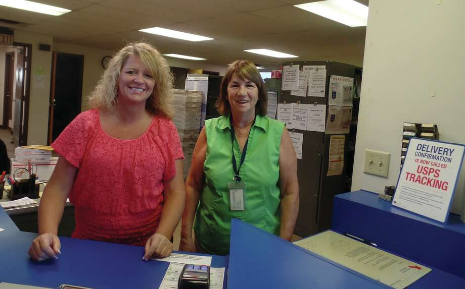 There are three part-time postal workers at the U.S. Post Office in Deford. From left, Kathy Elizando has worked for the post office for about 10 months, and Kathy Peruski has worked at the Deford Post Office for 22 years. The other route driver (missing from the photo) is Cheryl Laming, who has worked there about six months. / Copyright 2012