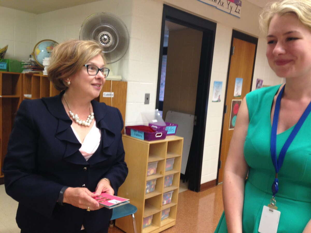Commissioner of Education Dianna Wentzell visits Lauren Morrissey, on her first day as a kindergarten teacher at Fawn Hollow Elementary School in Monroe on the first day of school, Sept. 1, 2016.