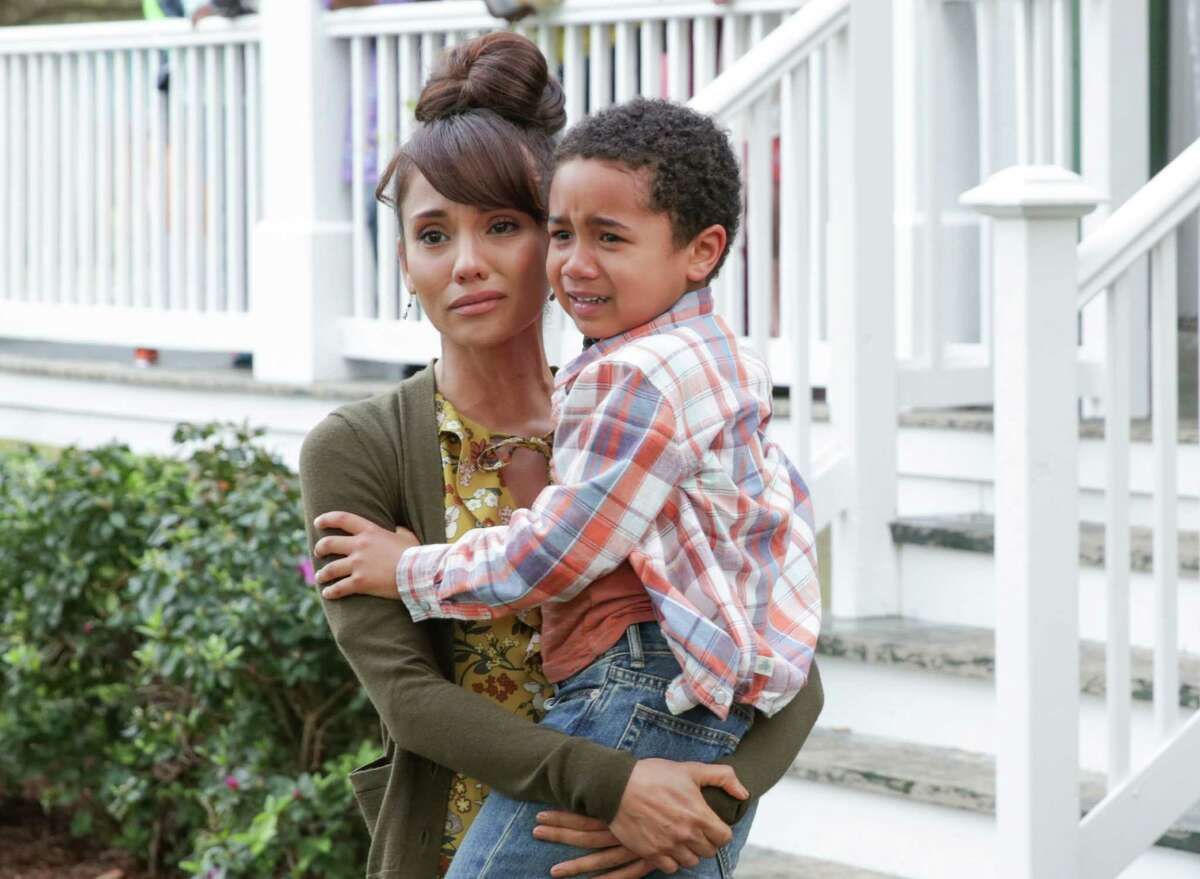 Elementary school teacher Reyna (San Antonio's Marycarmen Lopez) comforts an emotional Blue when a family tragedy happens during a birthday party in 'Queen Sugar' on OWN.