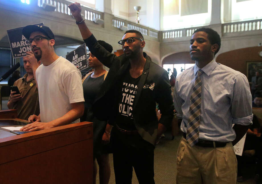 Zechariah Gonzales (left) speaks Thursday September 1, 2016 at City Council Chambers about why the San Antonio Police Officers Association's collective bargaining agreement should not be passed. After a two year fight, City Council voted to approve the deal with the SPOA. Mayor Ivy Taylor voted for approval and council members Rey Saldana and Ron Nirenberg voted against it. Photo: John Davenport, San Antonio Express-News / ©San Antonio Express-News/John Davenport