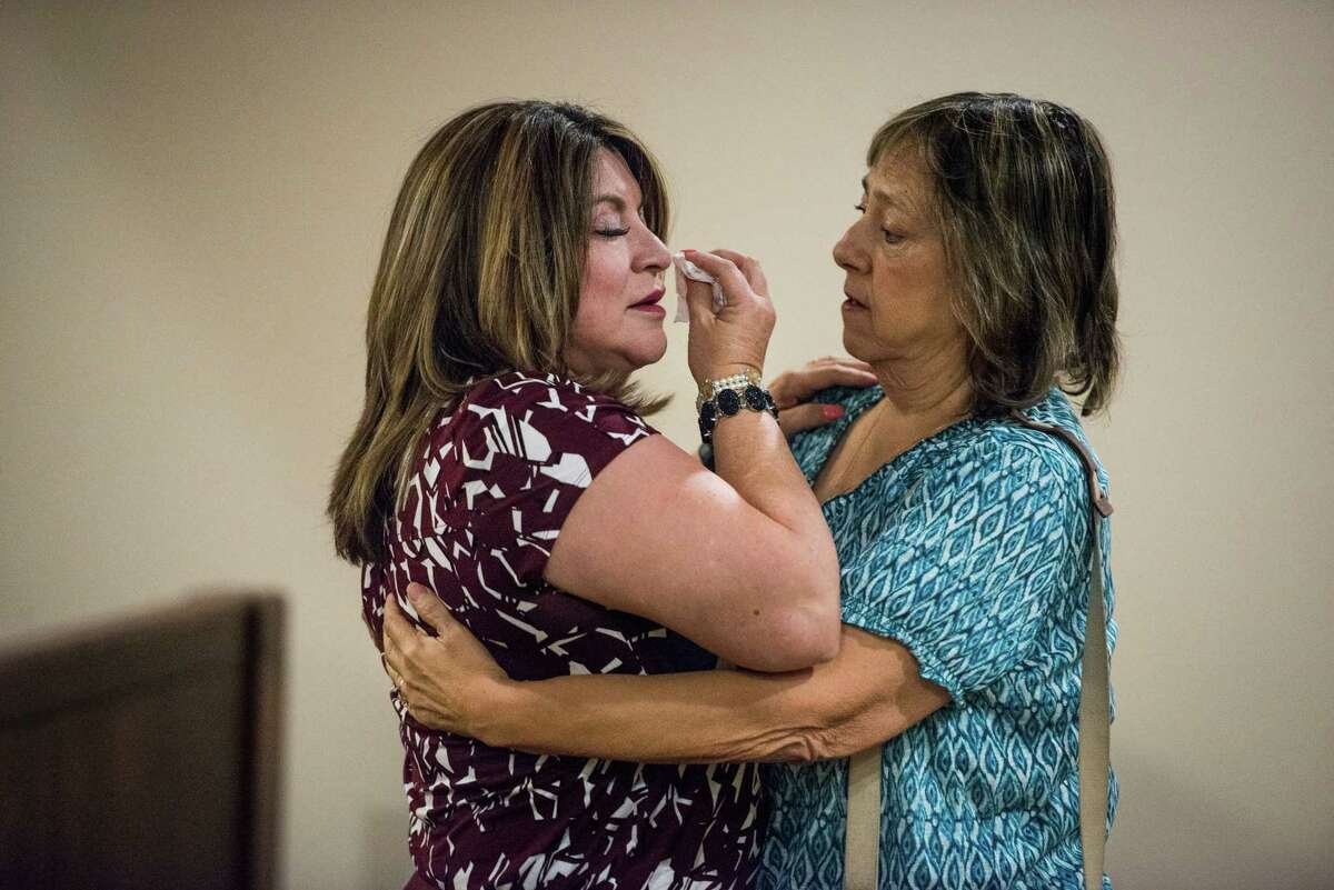Frances Hall, 53, left, is comforted by Ester Martinez, the aunt of her deceased husband, Bill Hall Jr., the man she is accused of murdering, during the third day of Hall's murder trial in San Antonio, Texas on Thursday, September 1, 2016. The District Attorney's office said she killed her husband of 32 years in a fit of jealousy by running his motorcycle off the road on Oct. 10, 2013. The death was ruled a homicide. Lawyers for Frances Hall, 53, said it was an accident.