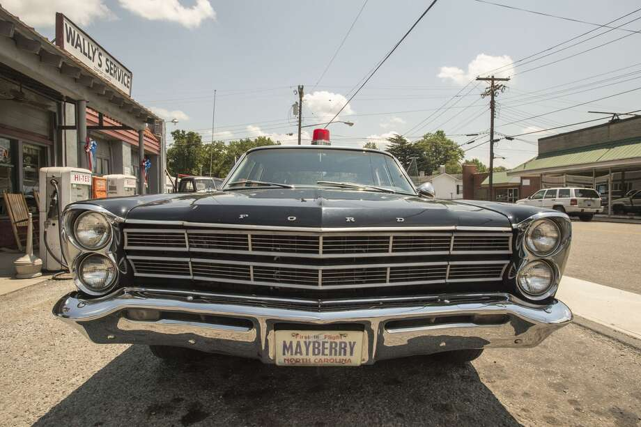 A vintage Ford Galaxie 500, decorated as a Mayberry police car, serves an Andy Griffith-themed tour-mobile of Mount Airy, N.C. MUST CREDIT: Photo by Jay Westcott for The Washington Post Photo: Jay Westcott/For The Washington Post