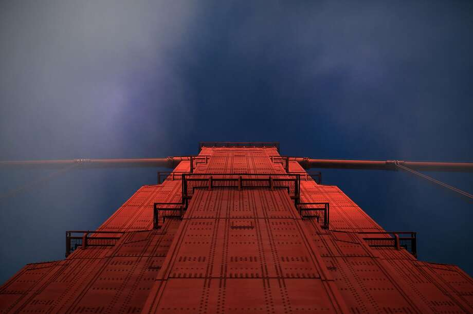 Early morning fog whips the top of the north tower of the Golden Gate Bridge. Photo: Mike Kepka, The Chronicle