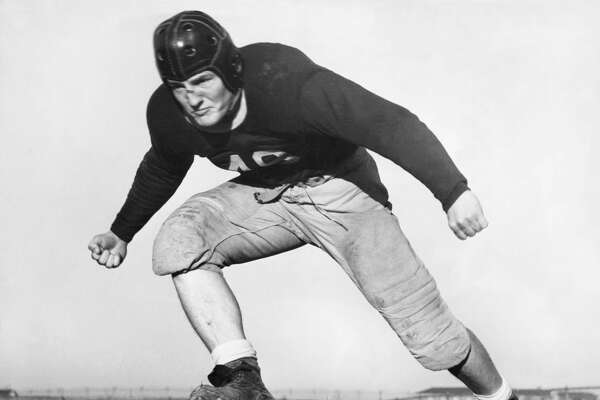 An action portrait of Texas Christian University's All-American football center, Charles 'Ki' Aldrich, Ft Worth, Texas, December 1938. (Photo by Underwood Archives/Getty Images)