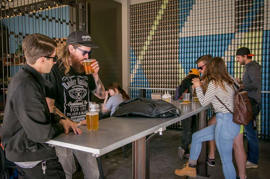 People drink beer at the Fort Point Brewery kiosk at the Ferry Building. Led in part by its kölsch, Fort Point has become one of San Francisco's most popular beers. Photo: John Storey, Special To The Chronicle
