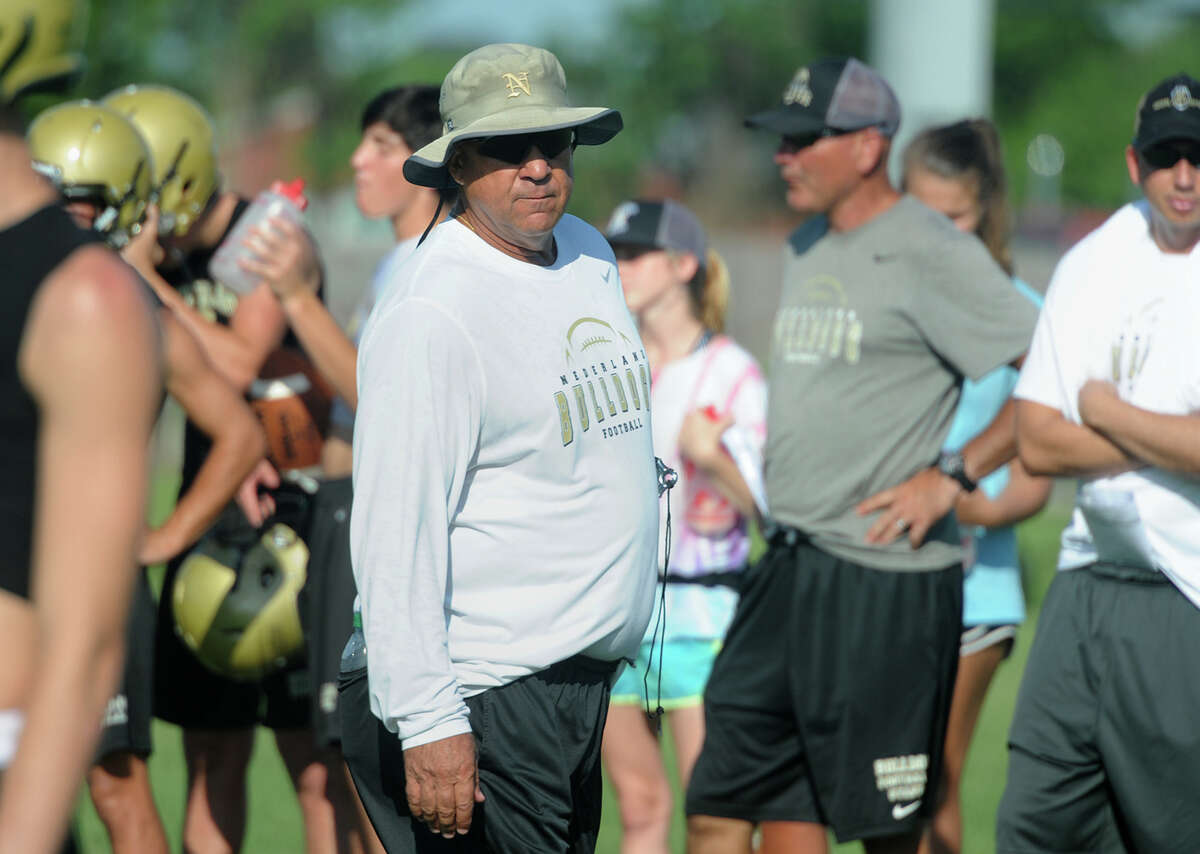 Larry Neumann works with his players during the first week of practice for the 2016 football season. Photo taken Wednesday, August 03, 2016 Guiseppe Barranco/The Enterprise