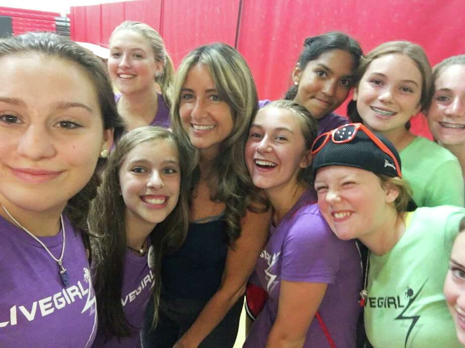"Fairfield County middle schoolers take a ""selfie"" with keynote speaker Wendy Sloane at Camp LiveGirl at New Canaan High School. August 2016. Photo: Contributed Photo / Contributed Photo / New Canaan News"