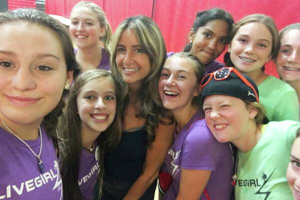 """Fairfield County middle schoolers take a """"selfie"""" with keynote speaker Wendy Sloane at Camp LiveGirl at New Canaan High School. August 2016."""