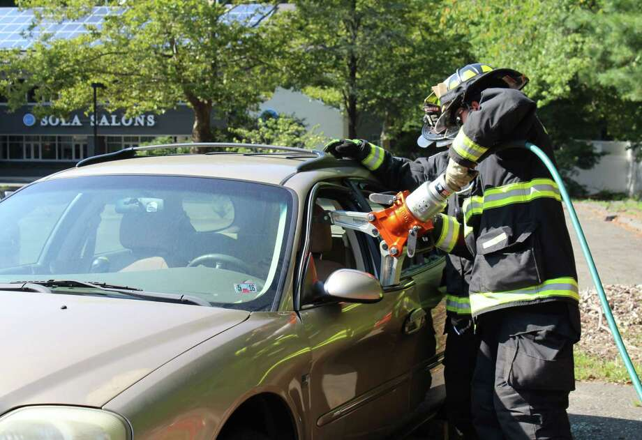 Probationary firefighter Adam Gamble practices a car rescue as part of his training with the fire department at headquarters in Westport, Conn. on Aug. 26, 2016. Photo: Laura Weiss / Hearst Connecticut Media / Westport News