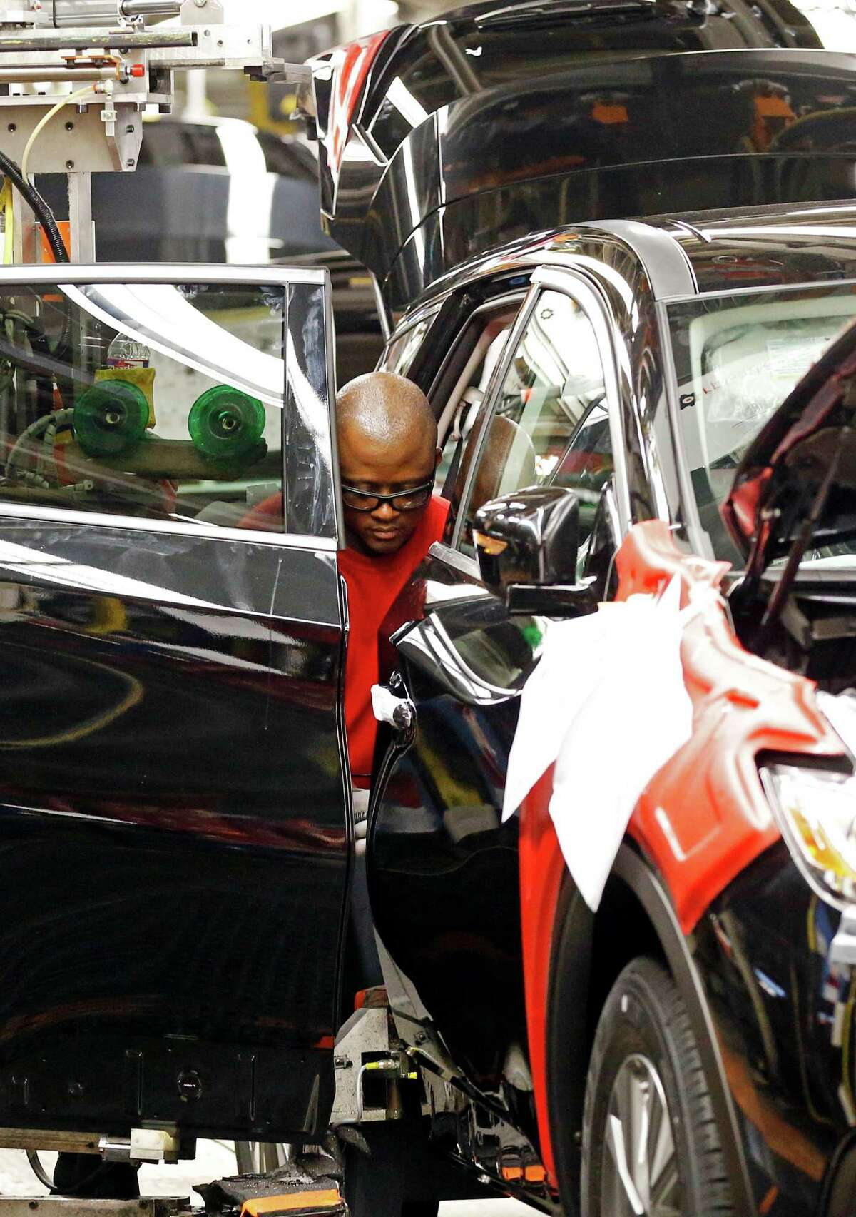 In this April 6, 2016, photograph, a technician works on a door assembly for a Nissan Altima on the assembly line at the Nissan Canton Vehicle Assembly Plant in Canton, Miss. On Thursday, Sept. 1, 2016, major automakers report sales figures for August. (AP Photo/Rogelio V. Solis) ORG XMIT: NYBZ402