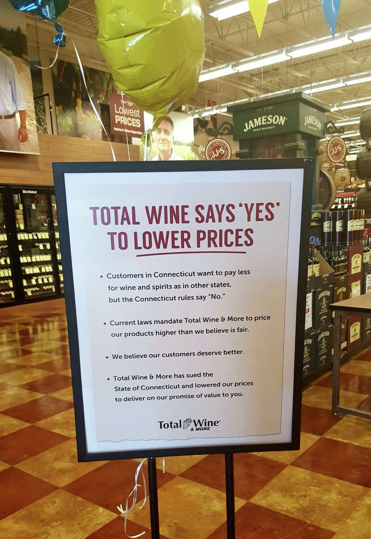 Total Wines had signs telling customers it was challenging Connecticut's pricing laws.
