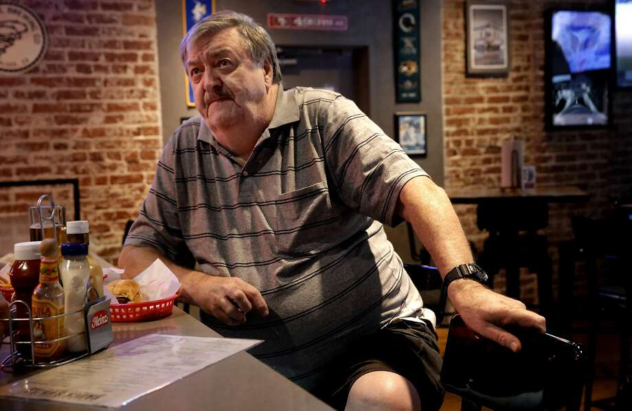 Mike Anderson, a Vietnam Veteran, sitting at Hauck's Grill, disagrees with the way Colin Kaepernick is sitting down during the national anthem in protest.  Photo: Michael Macor, The Chronicle