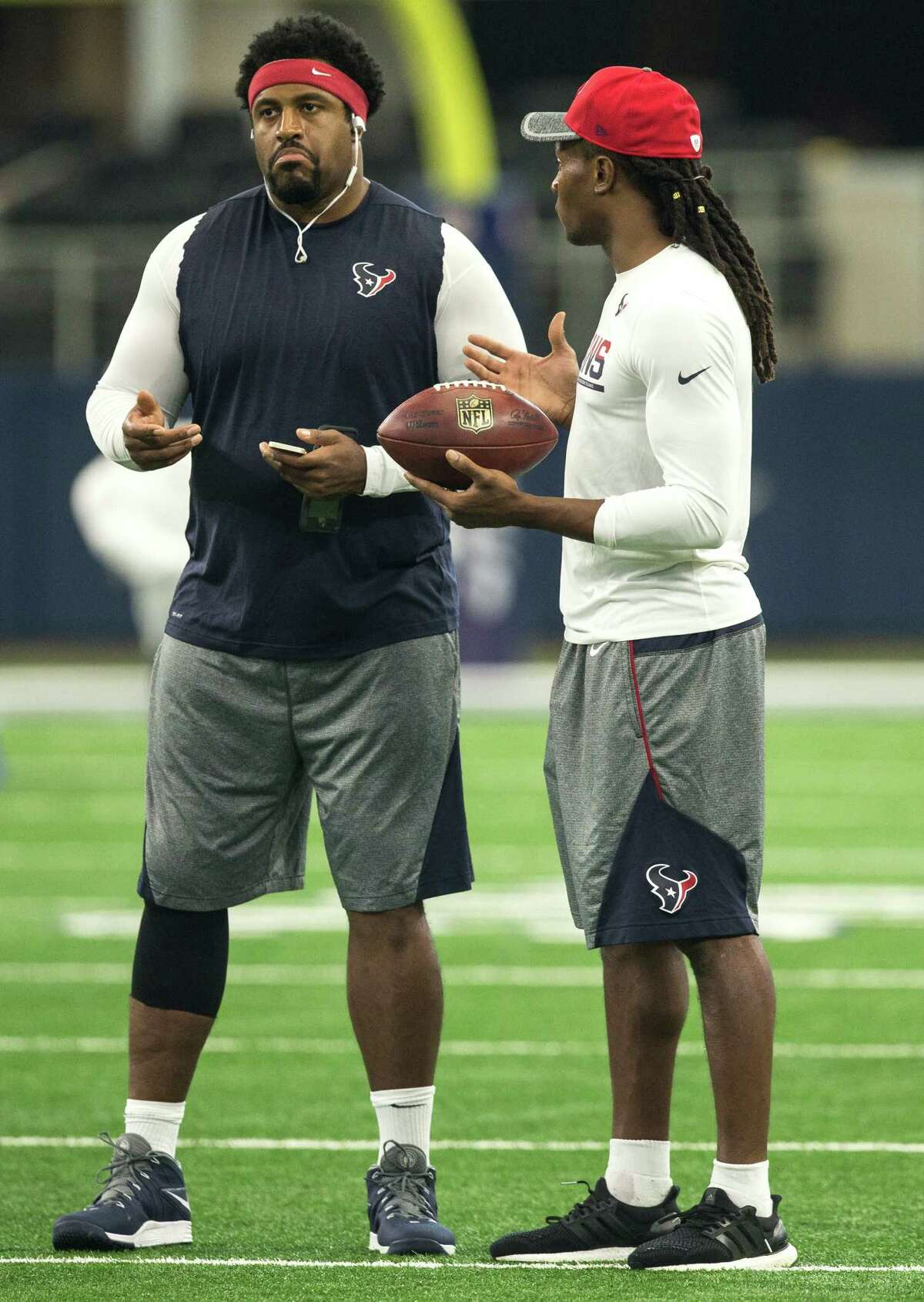Houston Texans tackle Duane Brown and wide receiver DeAndre Hopkins stand on the field before an NFL pre-season football game against the Dallas Cowboys at AT&T Stadium on Thursday, Sept. 1, 2016, in Arlington, Texas.
