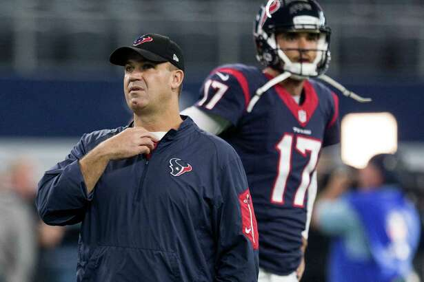 Houston Texans head coach Bill O'Brien and Texans quarterback Brock Osweiler stand on the field before an NFL pre-season football game against the Dallas Cowboys at AT&T Stadium on Thursday, Sept. 1, 2016, in Arlington, Texas.