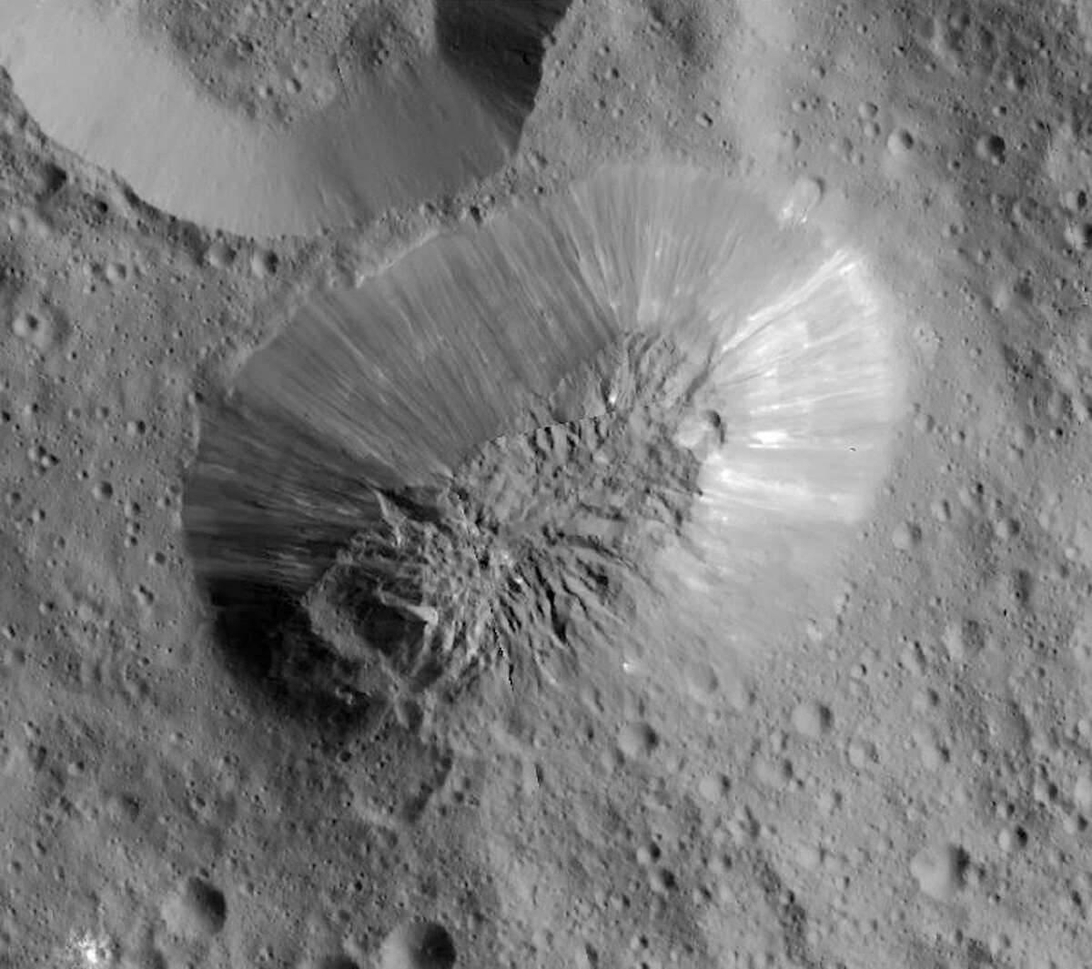 This image provided by NASA, shows an inactive volcano on the surface of Ceres, the largest object in the asteroid belt between Mars and Jupiter. Scientists said the volcano on the dwarf planet Ceres is about half as tall as Mount Everest. (NASA/JPL-Caltech/UCLA/MPS/DLR/IDA via AP)