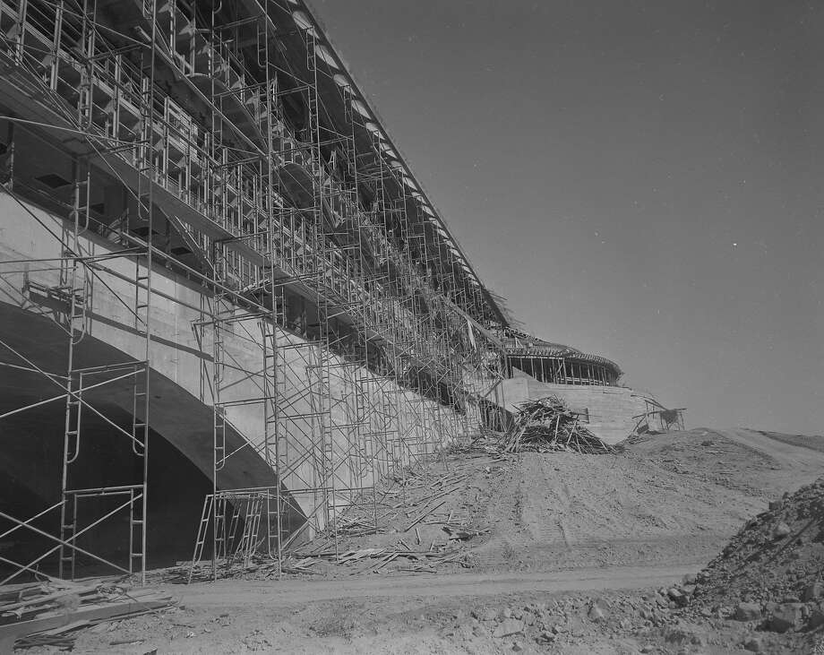 The construction of the Marin County Civic Center includes a massive arch, which links the two hills upon which the ends of the building rest on Aug. 9, 1961. Photo: Art Frisch, The Chronicle