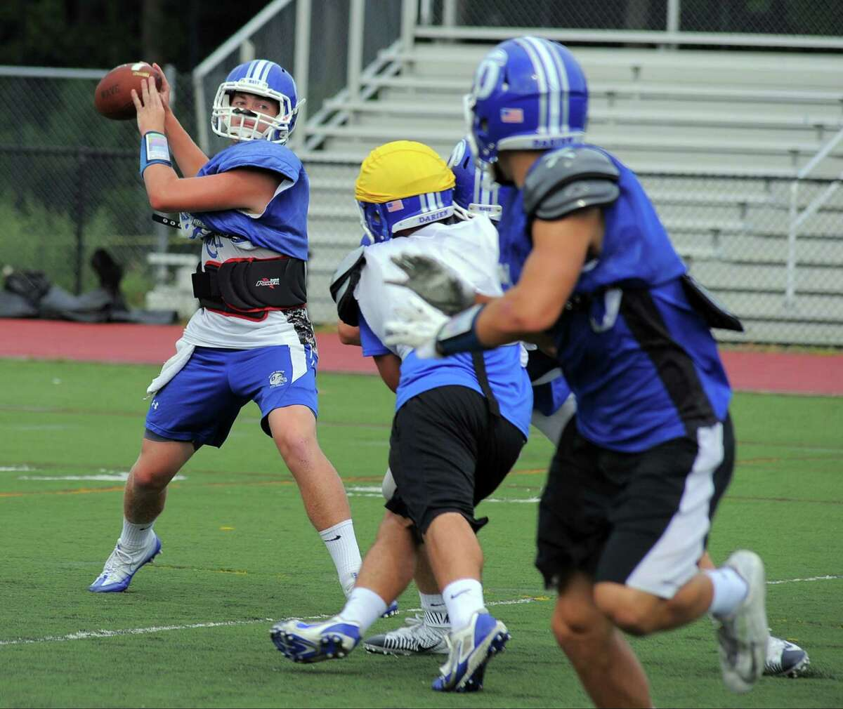 Darien quarterback Brian Peters looks to pass downfield to a receiver at a varsity football practice at the high school in Darien on Sept. 1, 2016. Finlay Collins
