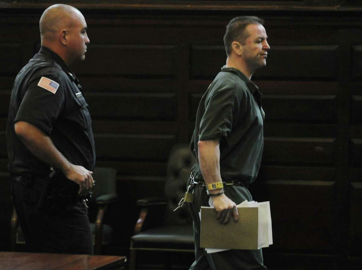 Michael Mosley leaves the courtroom after being sentenced in Judge Robert Jacon's courtroom at the Rensselaer County Courthouse on Tuesday morning, July 12, 2011, in Troy, N.Y. (Paul Buckowski / Times Union archive)