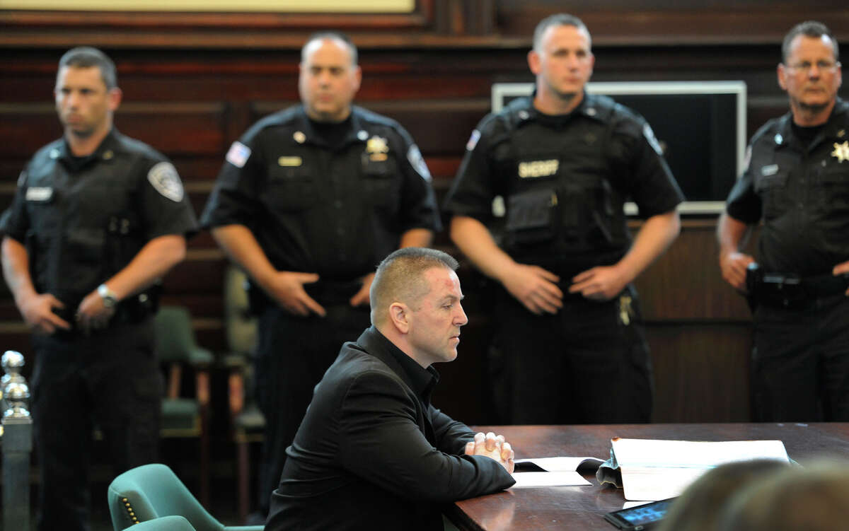 Michael Mosley, center shows no emotion after being convicted on a charge of murder in Rensselaer County Court House on June 2, 2011, in Troy, N.Y. (Skip Dickstein / Times Union archive)