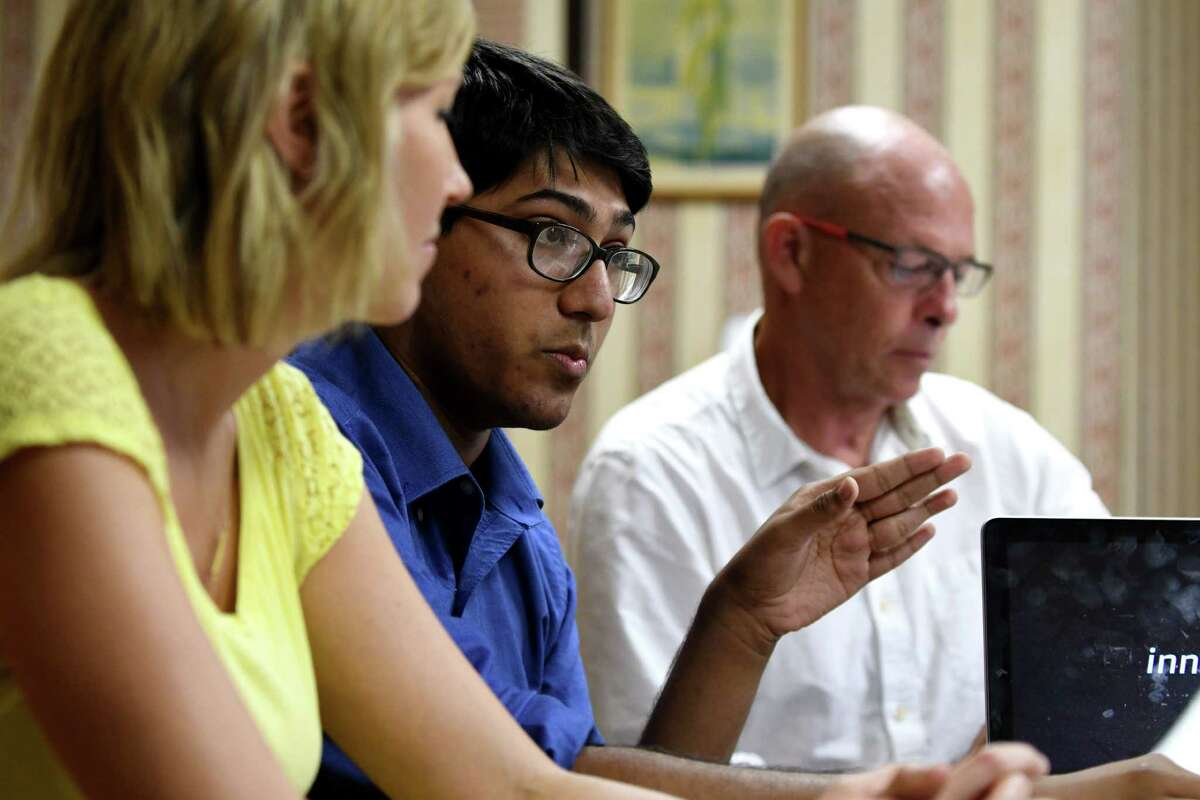 Unnas Hussain, an incoming senior at Shaker High School, center, talks about the North Colonie school district?'s new half-credit program where students can help other students with tech needs on Monday, Aug. 15, 2016, during an interview in Colonie, N.Y. With Hussain are; Lauren Sheeler, a Spanish teacher and dean for grades 11 and 12, left, and Gary Cimorelli, technology integration specialist for the district, right. (Will Waldron/Times Union)