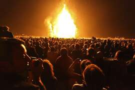 A crowd watches a the temple burn during Burning Man in 2011.