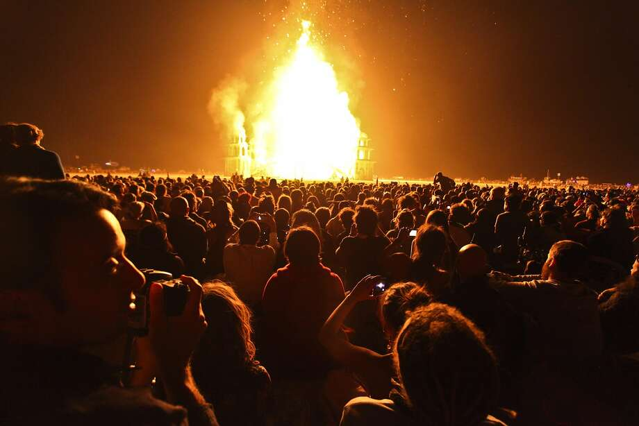 A crowd watches temple burn during Burning Man in 2011. Photo: Sam Wolson, Special To The Chronicle