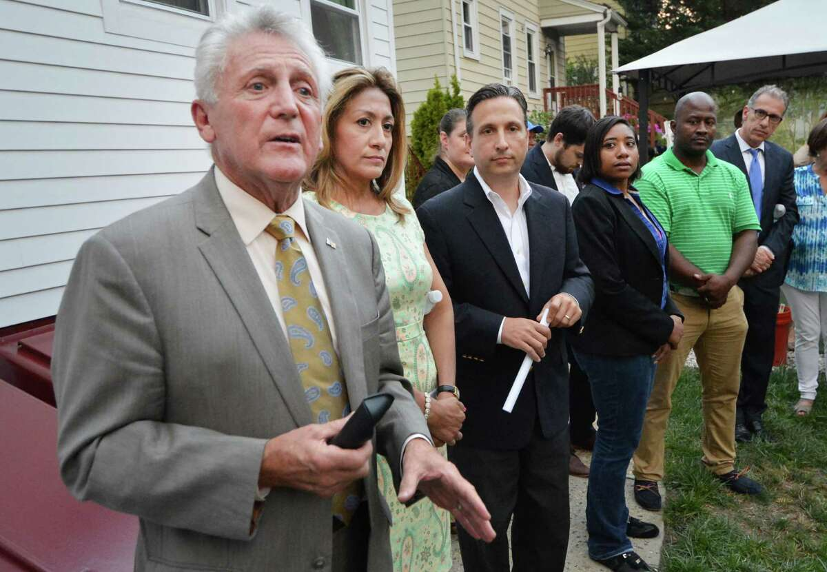 Norwalk Mayor Harry Rilling speaks to more than 100 gathered about the integrity of the neighborhood during a meeting of the Quintard Ave, Neighborhood Assoc. at 19 Quintard Ave, Thursday evening September 1, 2016 . Residents are opposed to a proposed halfway house next door at 17 Quintard Ave in Norwalk Conn.
