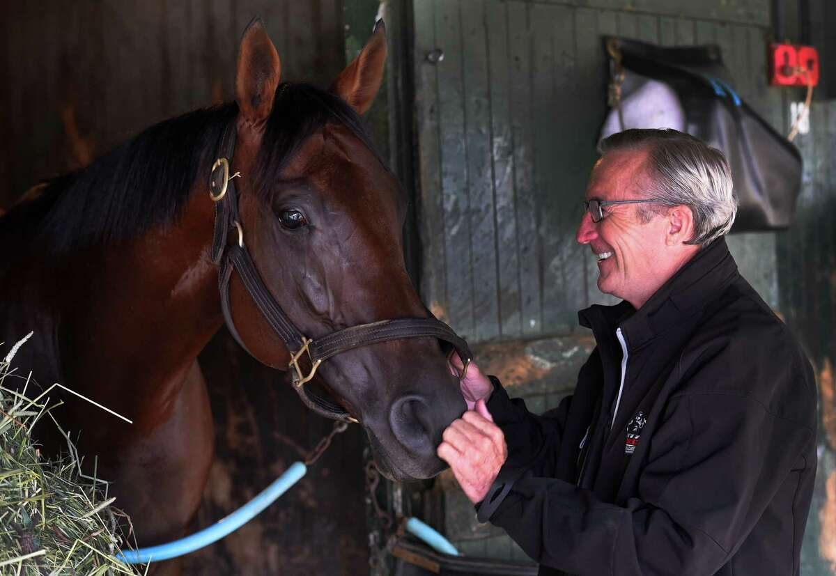 Trainer Rick Violette stands with his charge Samrat at his barn on the Saratoga Race Course Wednesday August 31, 2016 at in Saratoga Springs, N.Y. (Skip Dickstein/Times Union)
