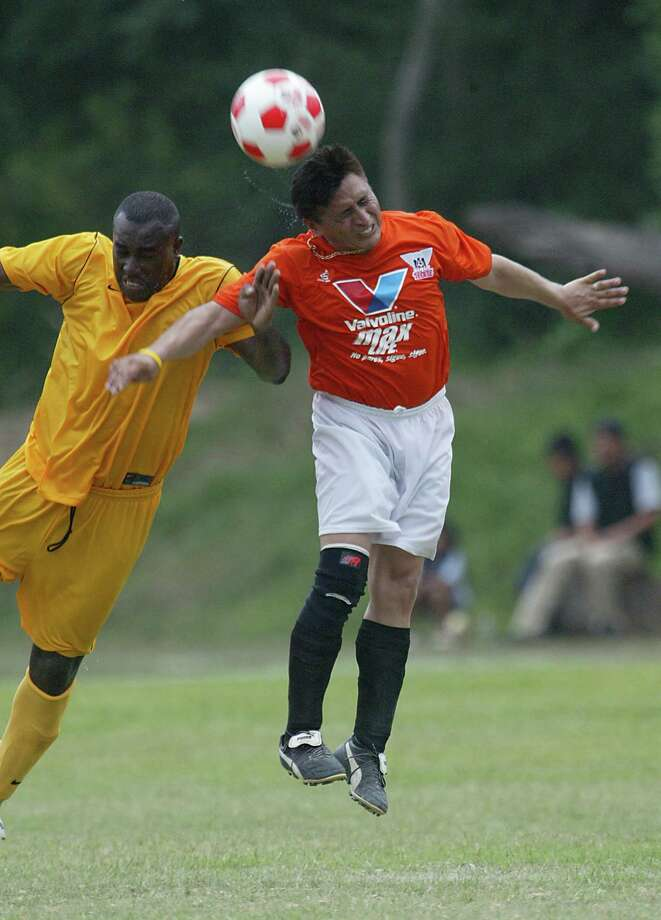 (left to right) Tafari (#13) Glendon Gibbs tries to block  Matamoros (#5) Amado Ortuno who drives the ball to his team during the soccer game at La Escondida Park in Houston, Tx. Matamors won 2-0, making it to the reginal July 24, 2005. Houston based Matamoros, representing the Hipano Soccer League vs. Tafari, representing Soccer Locker Leage, play a final soccer game in the fight for a spot in the Copa Tecate Championship game in San Diego, California August 2005. Copa Tecate is a national adult Hipanic amateur soccer tournament which includes 22 cities across the country.   5/29/05.  (Mayra Beltran/ Houston Chronicle) Photo: Mayra Beltran, Staff Photographer / Houston Chronicle