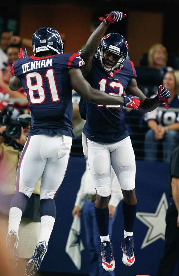Houston Texans wide receiver Keith Mumphery (12) leaps in the air with tight end Anthony Denham (81) celebrating his 64-yard touchdown reception against the Dallas Cowboys during the second quarter of an NFL pre-season football game at AT&T Stadium on Thursday, Sept. 1, 2016, in Arlington, Texas. Photo: Brett Coomer, Houston Chronicle / © 2016 Houston Chronicle