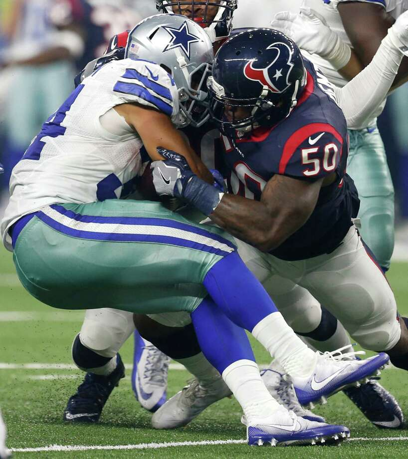 Houston Texans inside linebacker Akeem Dent (50) stops Dallas Cowboys running back Darius Jackson (34) at the line of scrimmage during the second quarter of an NFL pre-season football game at AT&T Stadium on Thursday, Sept. 1, 2016, in Arlington, Texas. Photo: Brett Coomer, Houston Chronicle / © 2016 Houston Chronicle
