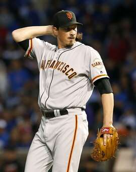 San Francisco Giants starter Jeff Samardzija reacts after Chicago Cubs' Chris Coghlan hit a one-run double during the first inning of a baseball game Thursday, Sept. 1, 2016, in Chicago. (AP Photo/Nam Y. Huh)