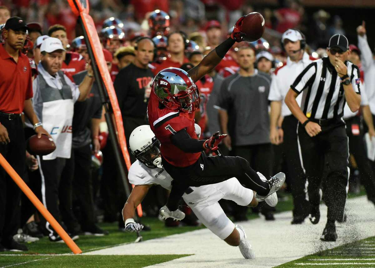 Western Kentucky's Nacarius Fant falls out of bounds while being tackled by a Rice player -=during the first half of an NCAA college football game Thursday, Sept. 1, 2016, in Bowling Green, Ky. (AP Photo/Michael Noble Jr.)