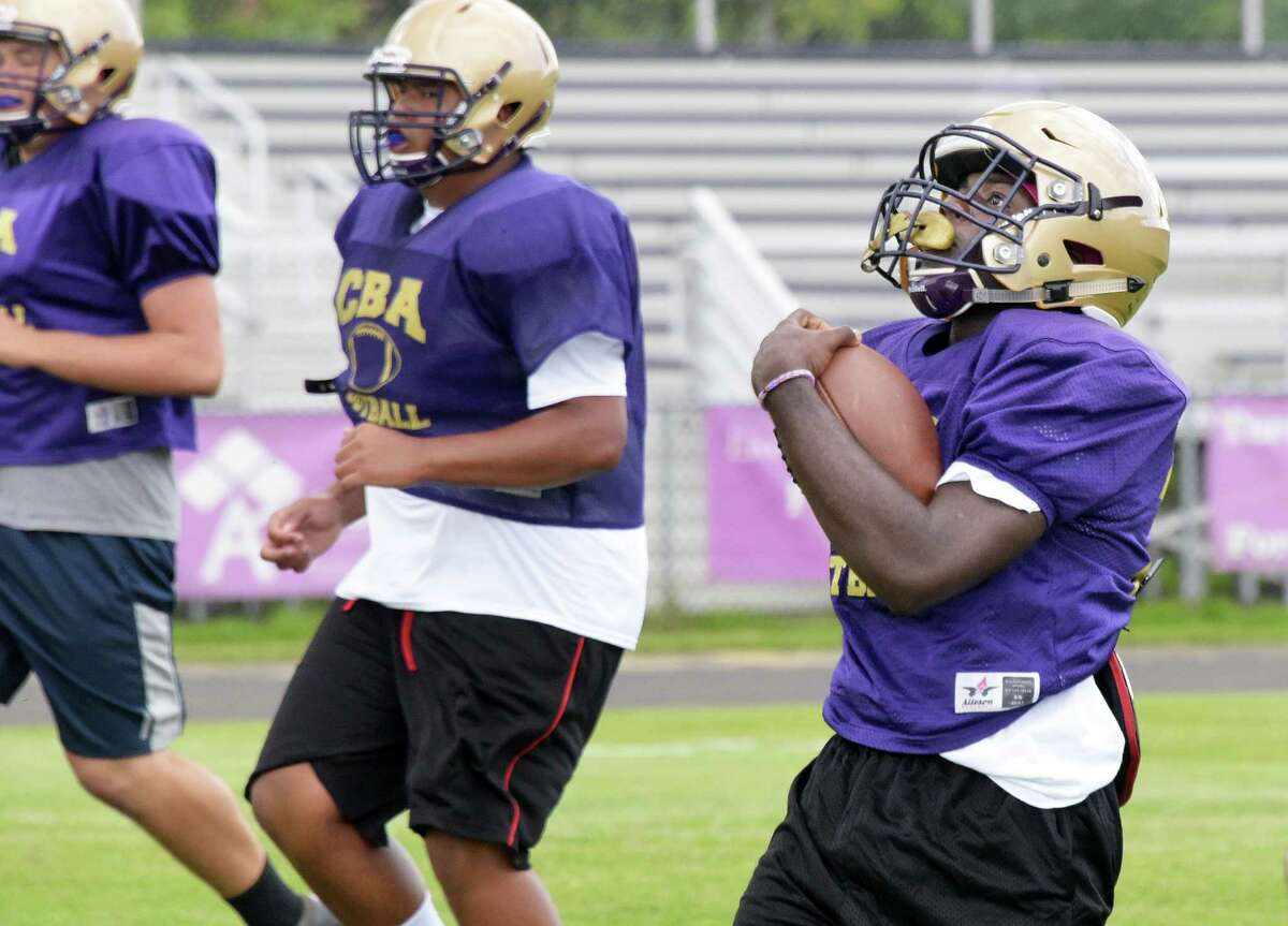 Christian Brothers Academy running back Taurian Taylor, right, during practice at the school Thursday Sept. 1, 2016 in Colonie, NY. (John Carl D'Annibale / Times Union)
