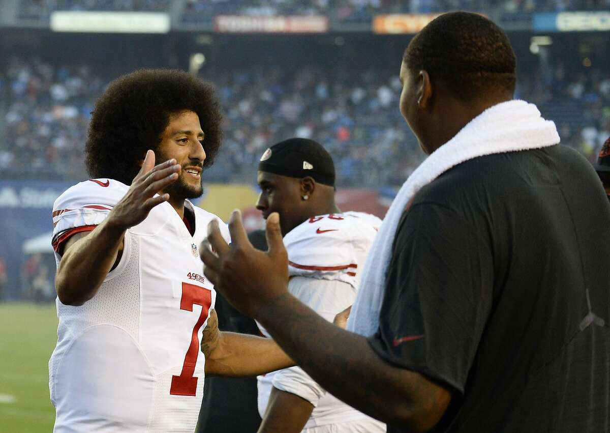 San Francisco 49ers quarterback Colin Kaepernick, greets teammates after sitting during the National Anthem before an NFL preseason football game against the San Diego Chargers, Thursday, Sept. 1, 2016, in San Diego.(AP Photo/Denis Poroy)