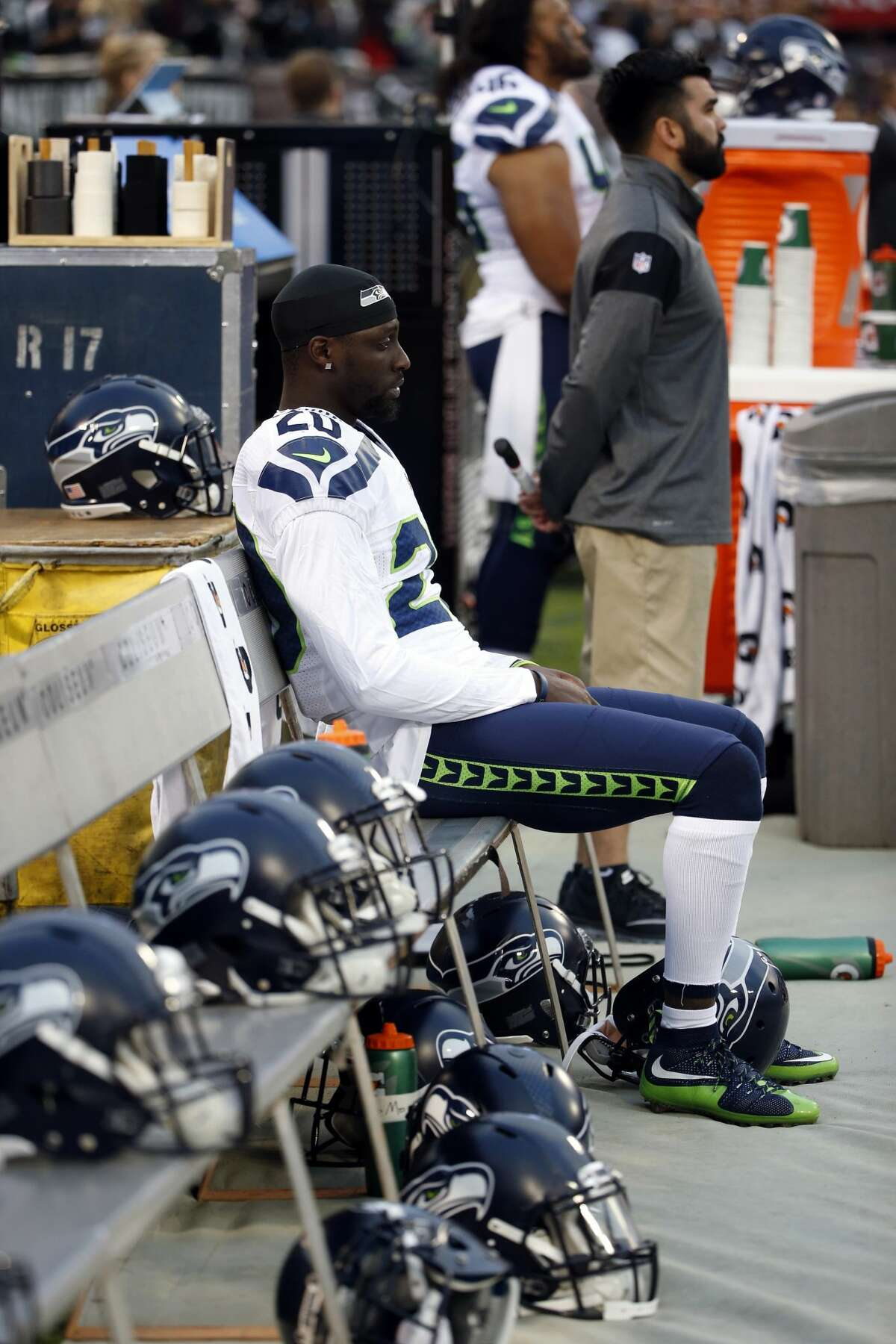 Seattle Seahawks cornerback Jeremy Lane sits as the national anthem plays before a preseason NFL football game against the Oakland Raiders, Thursday, Sept. 1, 2016, in Oakland, Calif. (AP Photo/Tony Avelar)