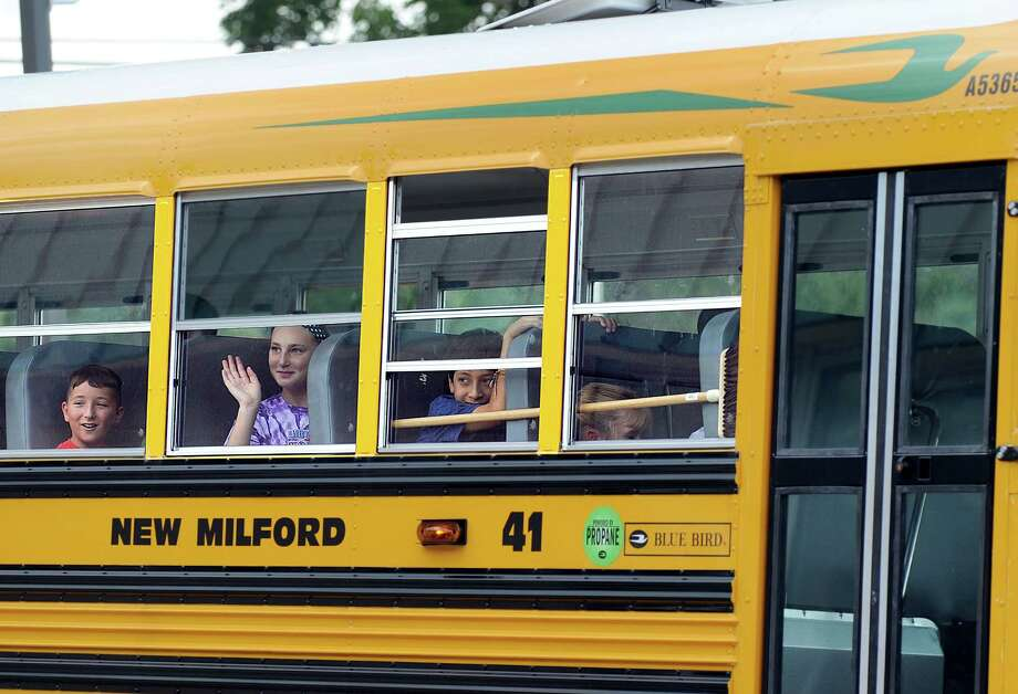 Students leave Schaghicoke Middle School in New Milford at the end of the school day in a propane-fueled bus Thursday. Photo: Carol Kaliff / Hearst Connecticut Media / The News-Times