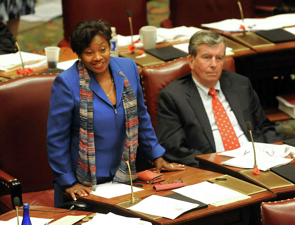 Senator Andrea Stewart-Cousins speaks as lawmakers work to vote on bills during session inside the Senate Chamber at the Capitol on Thursday, June 16, 2016, in Albany, N.Y. Senator Neil Breslin listens at right. (Lori Van Buren / Times Union archive)