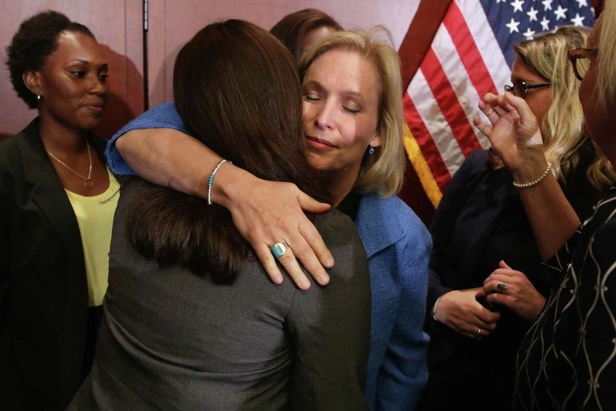 WASHINGTON, DC - JULY 30: Sen. Kristen Gillibrand (D-NY) embraces End Rape on Campus co-founder Andrea Pino, a survivor of sexual assult at the University of North Carolina, during a news conference about new legislation aimed at curbing sexual assults on college and university campuses at the U.S. Capitol Visitors Center July 30, 2014 in Washington, DC. With strong bipartisan support in the Senate, the bill would require schools to make public the result of anonymous surveys about campus assaults and impose significant financial burdens on universities that fail to comply with some of the law's requirements. (Photo by Chip Somodevilla/Getty Images)