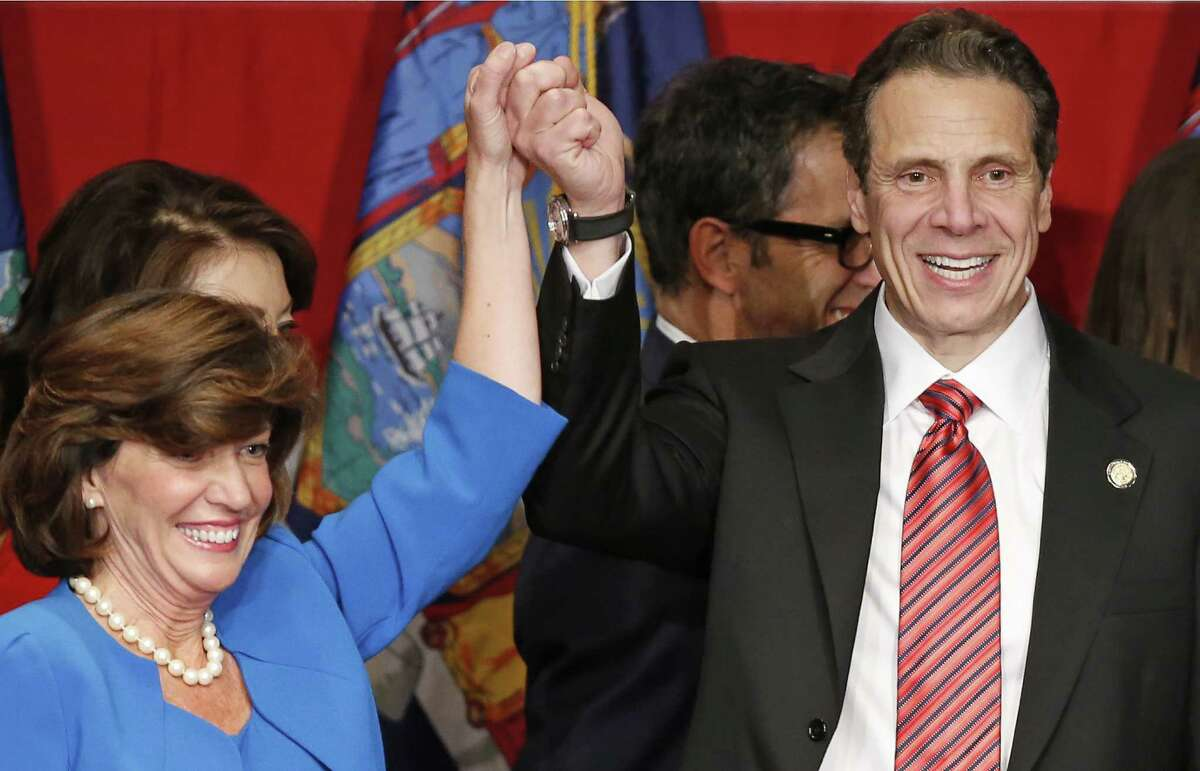 Democratic New York Gov. Andrew Cuomo, right, celebrates with Lt. Gov. Kathy Hochul after he cruised to victory Tuesday. But Cuomo lost the Capital Region and much of upstate New York. (AP Photo/Kathy Willens) ORG XMIT: MER2014110423262093
