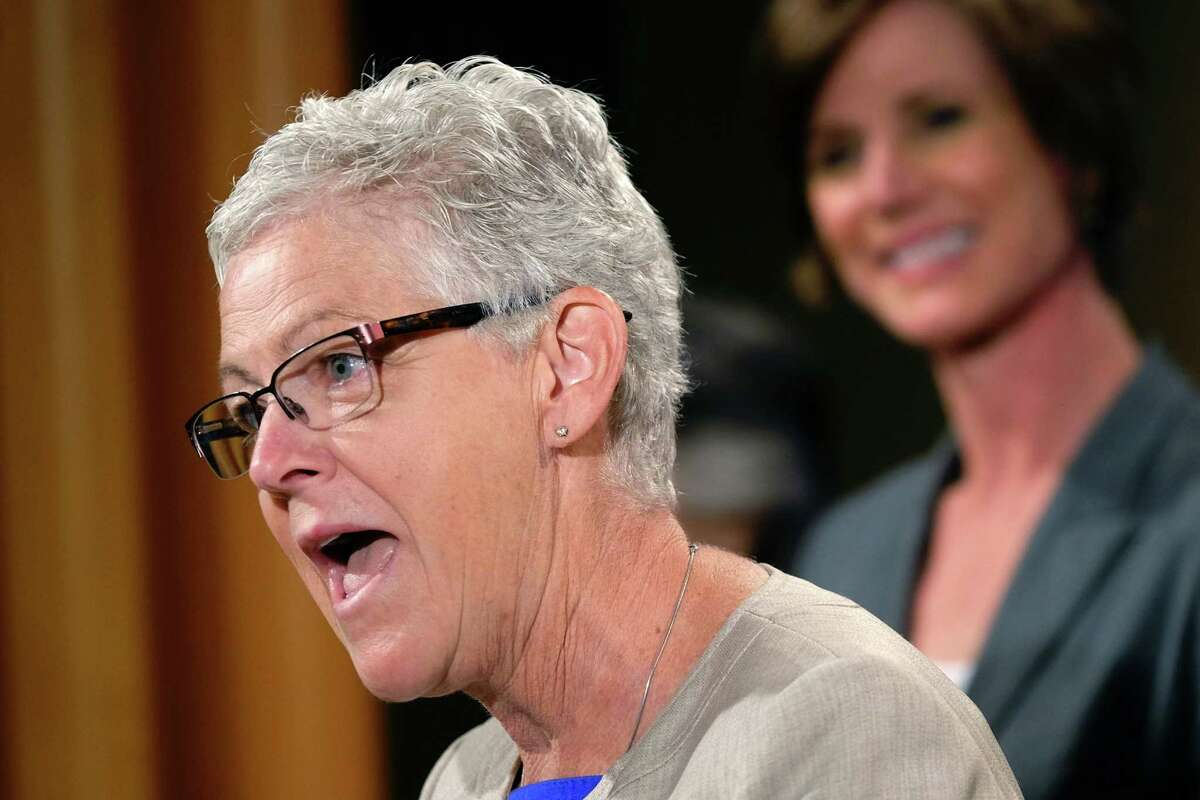 FILE - EPA Administrator Gina McCarthy, accompanied by Deputy Attorney General Sally Yates, announces the settlement with Volkswagen during a news conference at the Justice Department in Washington, Tuesday, June 28, 2016. McCarthy on Thursday fired back at New York?s commissioners for health and environmental conservation, who earlier this week accused the federal agency of giving ?conflicting guidance? about a toxic chemical that polluted multiple water supplies in eastern Rensselaer County. (AP Photo/J. David Ake)