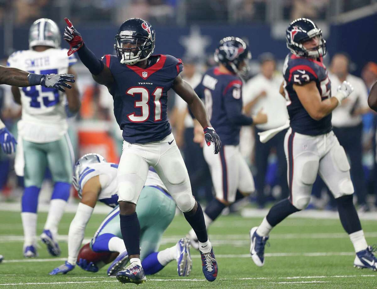 Houston Texans defensive back Charles James (31) celebrates making a play on a kickoff against the Dallas Cowboys during the second quarter of an NFL pre-season football game at AT&T Stadium on Thursday, Sept. 1, 2016, in Arlington, Texas.